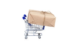 Shopping cart with box on white isolated Royalty Free Stock Image