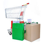 Shopping cart with boxes and bags Royalty Free Stock Photo