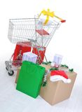 Shopping cart with boxes and bags Royalty Free Stock Images