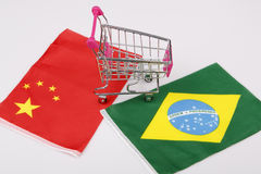 Shopping cart with Brasil and China flag Stock Image