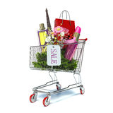 Shopping cart with bright gifts and paper bags  on white Royalty Free Stock Photo