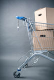 Shopping Cart with Brown Boxes Stock Photo
