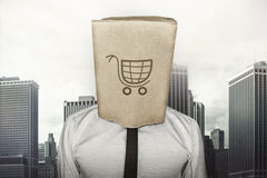 Shopping cart on brown paper bag which businessman Stock Photo