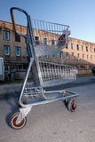 Shopping Cart In Building Parking Lot Royalty Free Stock Photography