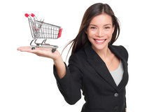 Shopping cart - business woman shopper. Woman showing holding mini shopping cart. Happy shopping or consumer loan concept with young female professional stock images