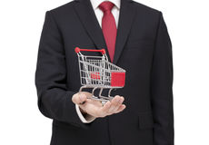 Shopping cart in businessman hand Royalty Free Stock Photos