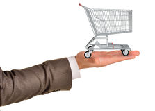Shopping cart in businessmans arm Stock Images