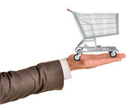 Shopping cart in businessmans hand Royalty Free Stock Photos
