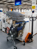 Shopping cart caddy full with merchandise in IKEA Stock Photos