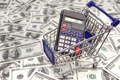 Shopping Cart with Calculator and 2015 sign on the Display Stock Photo