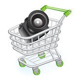 Shopping cart with camera Royalty Free Stock Image