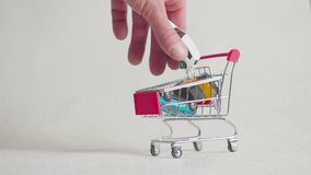 Shopping cart with car, buy car. Shopping cart with car, buy car stock video footage
