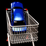 Shopping cart with car inside stock images