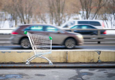 Shopping cart and cars Stock Images