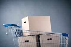 Shopping Cart with Carton Boxes Stock Photo
