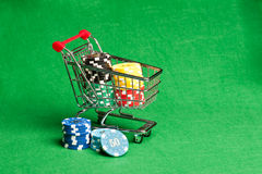 Shopping cart with casino chips Stock Photos