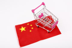 Shopping cart on China flag Stock Image