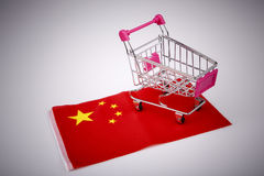 Shopping cart on China flag Royalty Free Stock Photo
