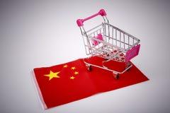 Shopping cart on China flag. Ping shopping cart on China flag - buying in china concept Royalty Free Stock Photo