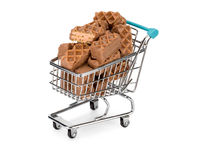Shopping cart with chocolate biscuits. Shopping cart filled with chocolate biscuits Stock Image