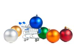 Shopping cart and christmas balls. Stock Photography