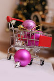 Shopping cart with Christmas balls Stock Image
