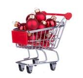 Shopping Cart With Christmas Balls Royalty Free Stock Photos