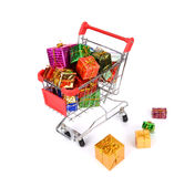 Shopping cart with Christmas gifts Stock Photography