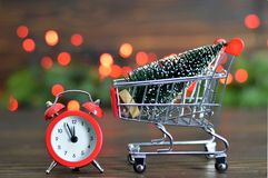 Shopping cart with Christmas tree Royalty Free Stock Photos