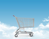 Shopping cart on clouds Stock Images