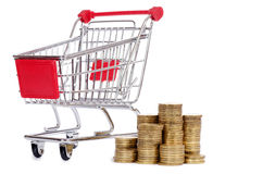 Shopping cart and coins Stock Photos
