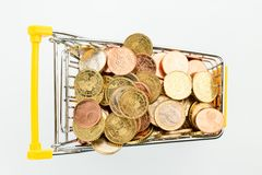 Shopping cart with coins Stock Image