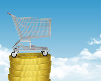 Shopping cart on coins stack Stock Photo