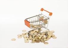 Shopping cart & coins Royalty Free Stock Photos