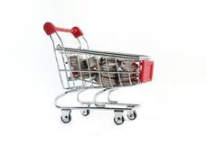 Shopping cart and coins Stock Photos