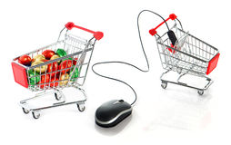 Shopping cart with colorful easter eggs Royalty Free Stock Photography