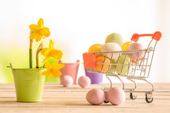 Shopping cart with colorful easter eggs Royalty Free Stock Image