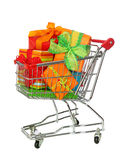 Shopping cart with colorful gift boxes. Isolated on white background Stock Image
