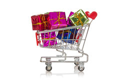 Shopping  cart with colorful gift boxes Royalty Free Stock Photos
