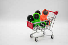Shopping cart with colorful LED spinners Royalty Free Stock Photography