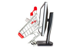 Shopping cart comes out of a monitor Stock Photo