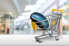 Shopping Cart with computer mouse on light Stock Image