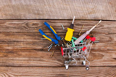 Shopping cart with construction tools Royalty Free Stock Photos