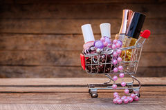 Shopping cart with cosmetics, beads, hair clip Stock Image