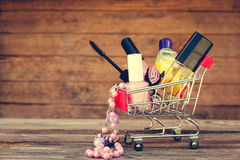 Shopping cart with cosmetics, beads, hair clip Royalty Free Stock Images
