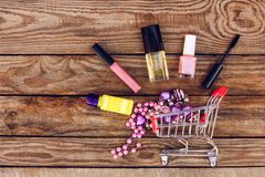 Shopping cart with cosmetics, beads Royalty Free Stock Image