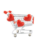 Shopping cart covered with hearts Stock Photos