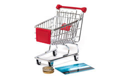 Shopping cart and credit card isolated Royalty Free Stock Photography