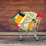 Shopping cart with credit cards and money Stock Images