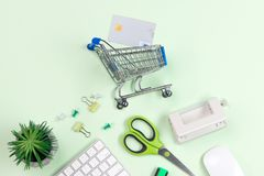 Shopping cart with credit cards on old wood background.  Stock Images